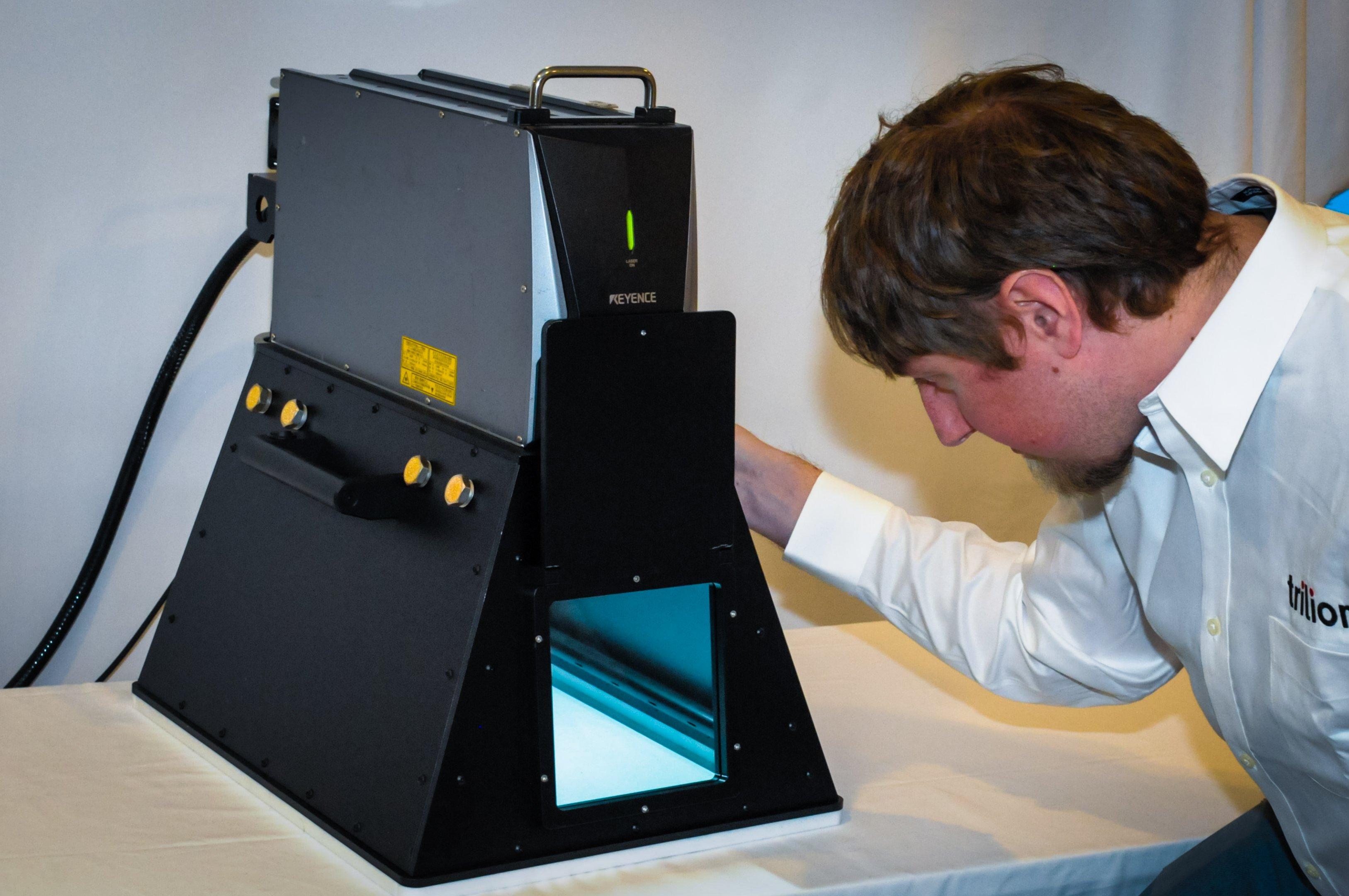 Trilion Laser Etching Manual System (LEMS) etching sheet metal